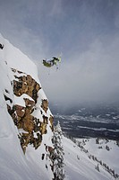 A male skier drops a cliff, Kicking Horse Backcountry, Golden, BC