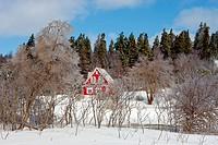 Red house in winter, New Glasgow, Prince Edward Island, Canada.