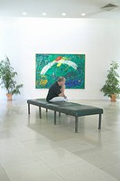 Tourist looks at paintings by Marc Chagall, Marc Chagall Museum, Nice, France