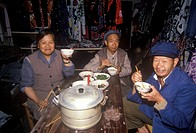 Family eating dinner in Dali, Yunnan Province, People´s Republic of China