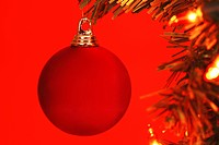 Close_up of a decorated Christmas tree against colored background