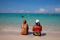 Two girls on the beach Tropicoco in Havana, Cuba