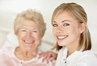 Nurse sitting with a senior woman