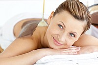 Relaxed young woman enjoying a beauty treatment with mud in a health spa