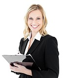 Glowing young businesswoman taking notes on her clipboars against white background