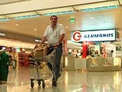 Athens Greece Athens Airport Man Pushing Luggage On Trolley