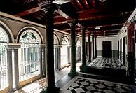 Drawing room, Nattukottai Chettiar house or Nagarathar house at Devakottai in Chettinad , Tamil Nadu  The gleaming black granite pillars are a dominan...