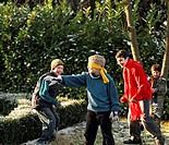 Portrait of children playing blindman's buff in the garden