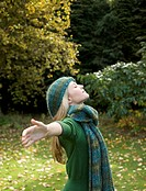 Profile of a young woman with arms outstretched