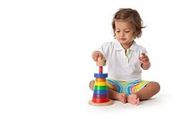 Toddler girl playing with colored bricks on white background