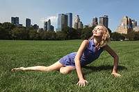 Young woman poses in Central Park, New York, USA