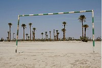 Sandy football field, football, palms, Rissani, Morocco,