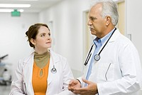 Doctor talking with female colleague