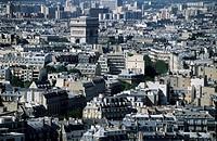 City buildings with the Arc de Triomphe in the distance, Paris, France.