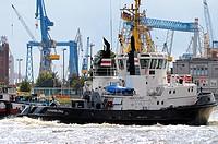 Cargo boat ship with cranes in Elbe near docks of Hamburg port