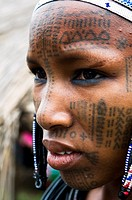 A Beautiful Peul / Fulani girl covered with facial tattoos in the Benin / Niger border area.