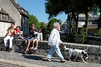 OLD WOMAN WITH HER DOG AND A FAMILY SITTING ON THE PONT BOUJU BRIDGE OVER THE EURE RIVER, OLD TOWN OF CHARTRES, EURE_ET_LOIR 28, FRANCE