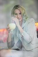 Woman having cocktail