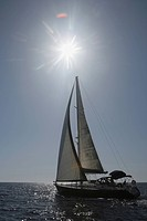 Scenic view of a sailboat sailing on a calm sea