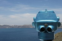 A coin operated telescope with the view of sea and mountain