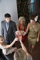 High angle view of five people toasting with champagne at holiday party
