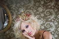 Portrait of contemplative blonde woman wearing crown