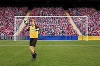 Goalkeeper throwing football