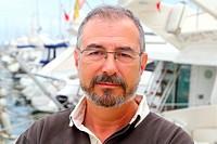 Senior man on marina sport boats portrait happy relaxed