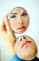 Mirror reflecting image of woman