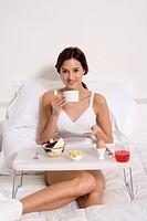 Woman having breakfast in her bed