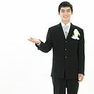 a bridegroom raising his hand