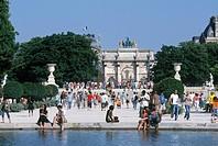 Arc de Triomphe du Carrousel at Jardin des Tuileries garden with the Louvre in back, Paris, France
