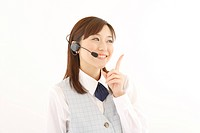 A woman with headset smiling