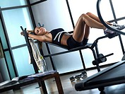 Woman relaxing after working out in gym