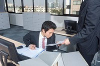 Manager showing employee document