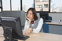 Office worker bored at office desk