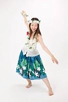 Young woman dancing the hula