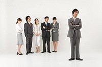 Businessman excluded from group of business people