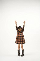 Girl standing with arms outstretched