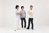 Three young men talking