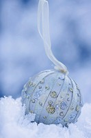 Christmas bauble in snow