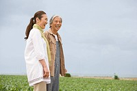 Senior couple standing in field