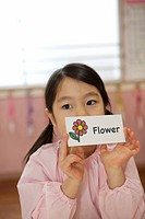 Kindergarten Girl Holding Picture Card