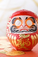 Daruma doll and gold coin