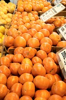 Oranges and mandarin oranges on a market stall