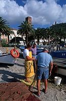 Italy, Liguria, Noli.Fishermen on the beach