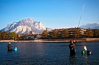Italy, Lombardy, Lecco, fishermen on the Adda river