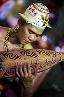 An Iban playing the traditional music instrument taken at Carpenter Street, Kuching, Sarawak, Malaysia during Mooncake Festival.