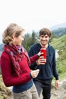 Man offering woman bottle