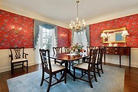 Dining room in luxury home with red floral wallpaper